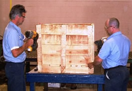 Custom designed wooden shipping crate being constructed